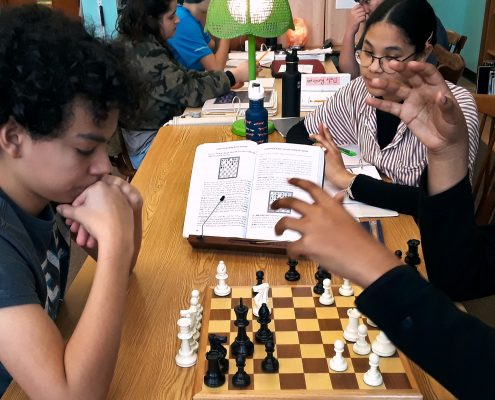 Middle School students in a game of chess